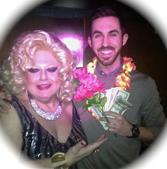 TUESDAYS AT CIBAR LOUNGE Latest big winner poses with cash, floral trimmings and Sultana!