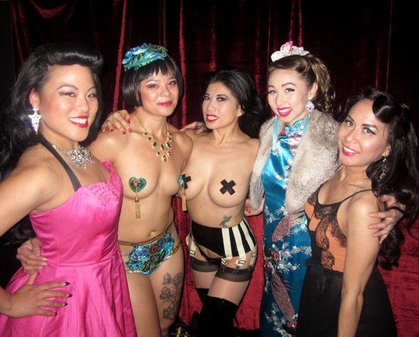 Calamity in the middle of her harem of performers.