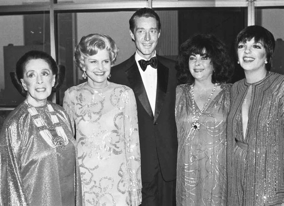 Halston in the 1970s, surrounded by some of his most famous clientele—choreographer Martha Graham, first-lady Betty Ford, movie star Elizabeth Taylor and singer Liza Minnelli. What a dazzling ensemble!